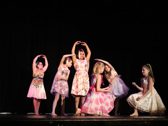 "A group of girls finish their performance of ""Wonderful World"" by Eva Cassidy with this elegant pose."