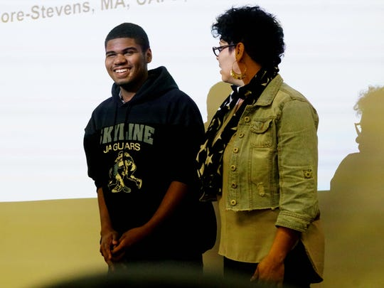 (left to right) Bryant Harper, 15, speaks to Wilmington police officers with his mother Yomayra Carmona, about being visually impaired, during a training session by the Delaware Division for the Visually Impaired for police officers.