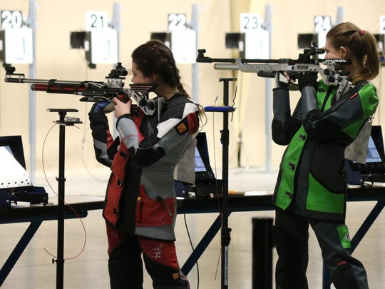 Micaela Lefever and Rachel Sprague, of the DuBois Junior Rifle Team, take aim during the Civilian Marksmanship Program's three-position air rifle regional championships at Camp Perry on Friday.