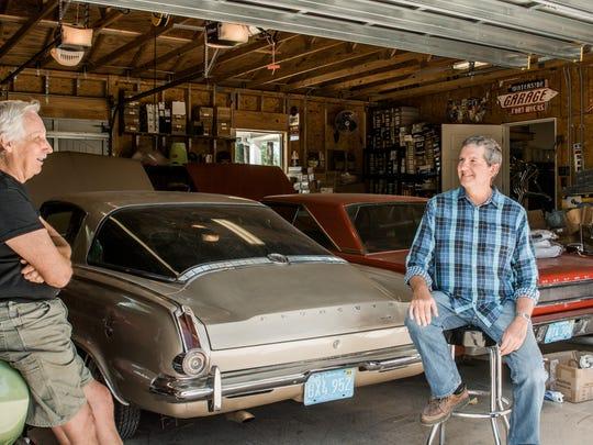 Dan Dodrill and Dennis Pennington discuss cars in Pennington's man cave at Horse Creek.