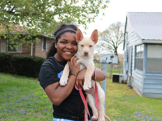 Phase three in the campaign encourages more play outside. UCHS junior, Ashyla Robinson, poses for a photo with her dog, Tucker, while out on a walk during the warm spring break weather last year.
