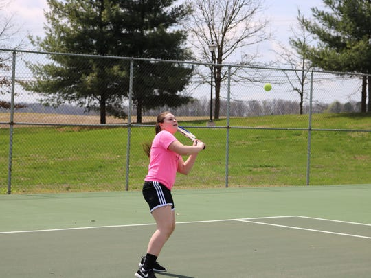 Eight grader, Jaden Walker, plays a round of tennis with her mom at the Morganfield City Park on Tuesday of Spring Break.