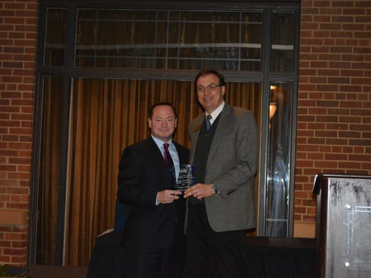 Patrick O'Neill wins the Legacy Award and accepts it