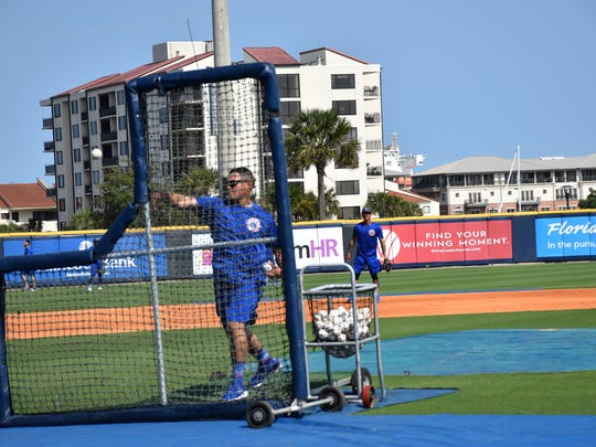 Tennessee Smokies coach Ricardo Medina throws battling practice Tuesday during his team's workout at Blue Wahoos Stadium.