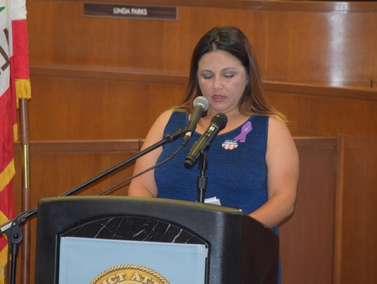 Regina Rutherford speaks during a ceremony to commemorate National Crime Victims' Rights week on April 5, 2017, at the Ventura County Board of Supervisors meeting room.