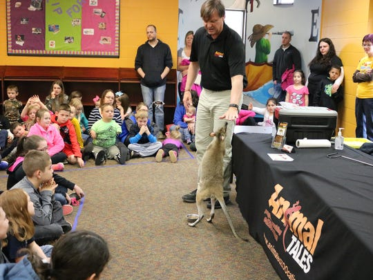 Animal Tales Director, Jeff Armstrong, presents the wallaby to the students during his program at the UC Public Library on Thursday afternoon.