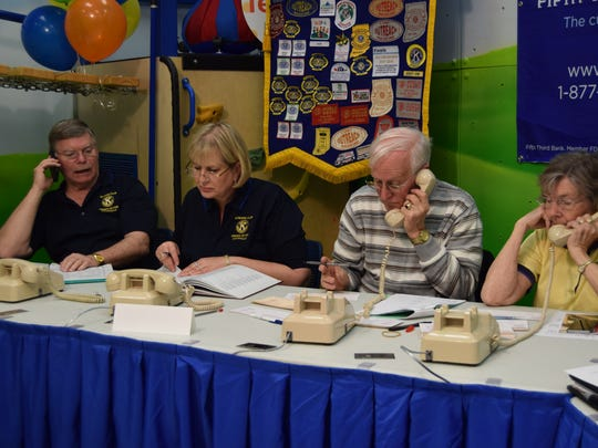Members of the Kiwanis Club answer telephones at the 40th annual Easter Seals Rehabilitation Center telethon Sunday.