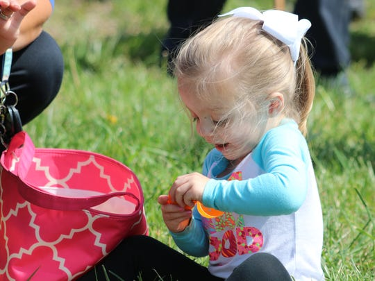 Sawyer Logan excitedly opens her eggs at the Breckinridge Services egg hunt on Saturday.