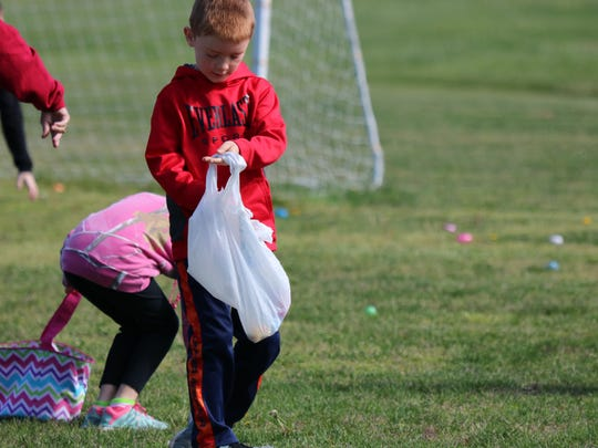 Righley Leslie fills his bag with eggs during the egg hunt at Earle C. Clements Job Corps.