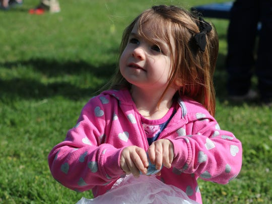 Presley Gregory opens her eggs at the Earle C. Clements Job Corps Egg Hunt.