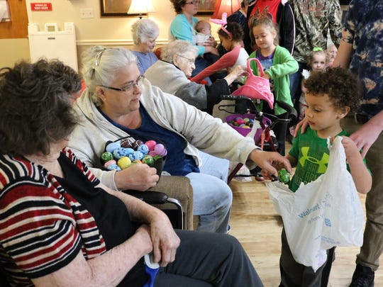 Jagger Brown receives eggs at the Easter event at the Morganfield Nursing and Rehab event.