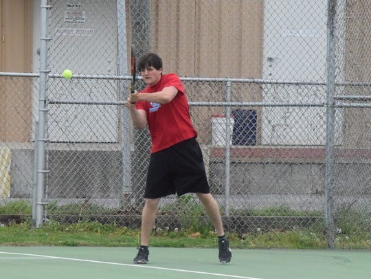 Bryce Steelman takes a swing at the ball.
