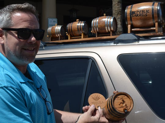 "Steve Kane, owner of Old Republic Barrels, showing off the removable faceplate options infront of the ""Barrel-mobile."""
