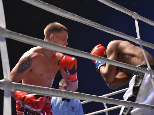 Pensacola's Devin Cushing has Alvin Brown in precarious position against ropes prior to Cushing's second-round knockout at the Pensacola Bay Center on April 14 at Island Fights 40