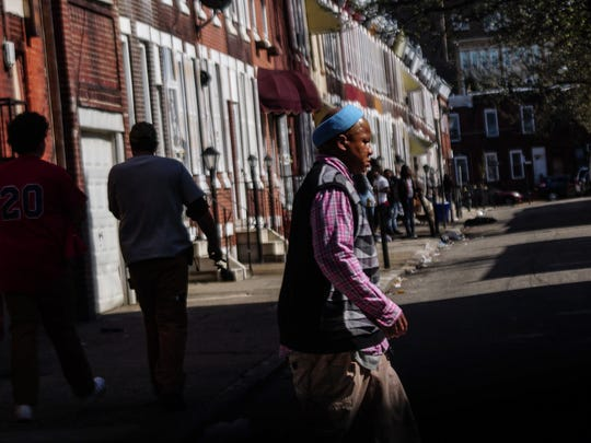A man walks along the streets of West Kensington in Philadelphia, home to what is considered the largest open-air drug market on the East Coast.