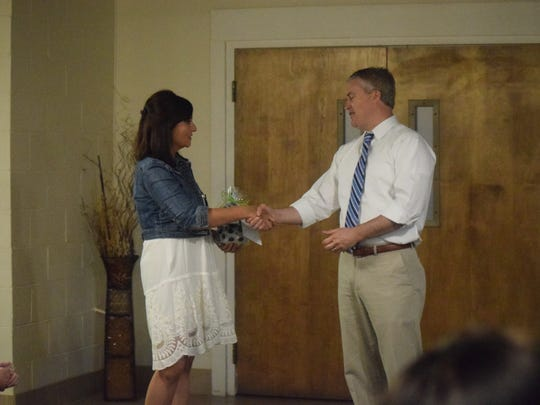 Lindsay Jenkins gives Congressman James Comer a gift