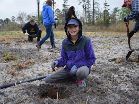 Isabela Saltar, 10, of Vineland, plants an American