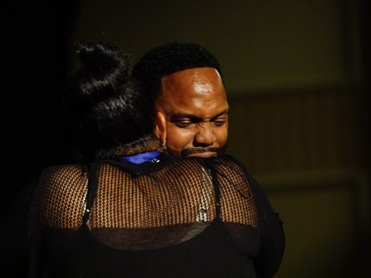 Fred Reed hugs his wife Cora after winning the Outstanding