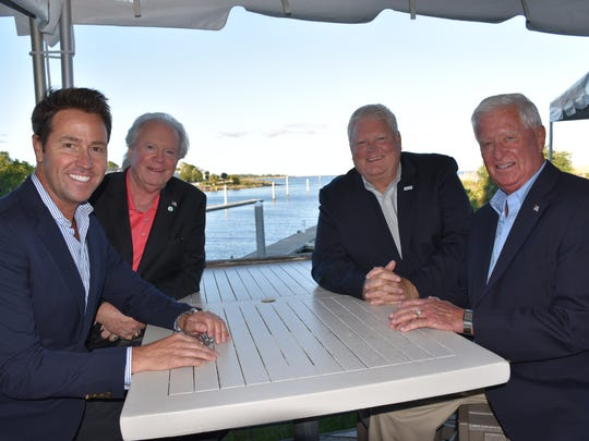 Pensacola mayor Ashton Hayword (front left) is joined by Barry Smith, president of the Florida Sports Hall of Fame, Wayne Hogan, the executive director and Gordon Sprague, now on the board of directors, during reception and informational briefing Monday at the Fish House about the HOF future.