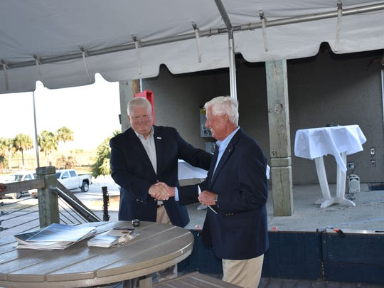 Florida Sports Hall of Fame executive director Wayne Hogan greets Gordon Sprague, a Gulf Breeze resident and business leader, now on the board of the directors for the Florida Sports HOF.