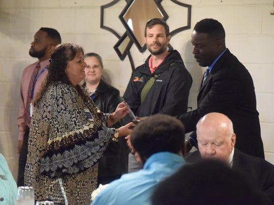Jennifer Buckman, school board chair person, accepts the award given to the Union  County Public Schools.
