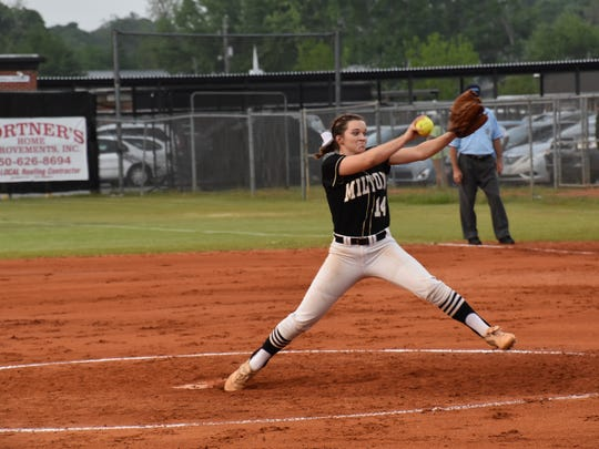 Milton High junior Megan Robertson delivers a pitch in Thursday night's District 2-7A championship game against Niceville
