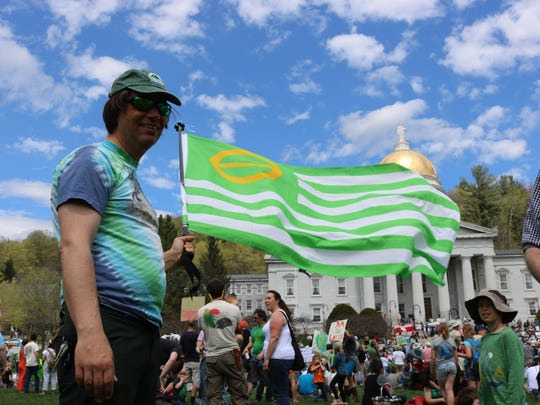 Brian Aust, a Vermont park ranger, shows off his ecology flag, which he ordered far in advance of the rally on Sat., April 29, 2017 in Montpelier and last week's Science March - of course.