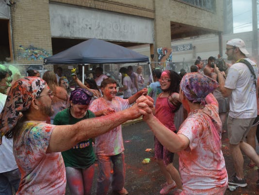 """Holi-Fest 2017 held Saturday in downtown Alexandria. Holi-Fest is a Hindu spring festival known as the """"festival of colors"""" because of the colored powder thrown during the celebration. The 6th annual Holi-Fest in Alexandria raises funds for the Children Advocacy Center. The festival this year was held in honor of the late Jeff Phillips, owner of the Tamp & Grind Coffee Shop in downtown Alexandria who played a main part of the  revitalization of downtown."""