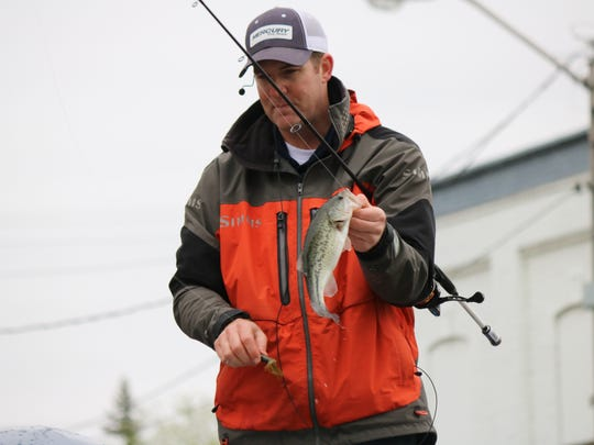 Pro fisherman Michael Simonton catches a bass during his demonstration utilizing the 2,500-gallon mobile tank during a previous Fremont Fishing & Outdoor Festival. This year's fest, set for May 16, has been canceled.