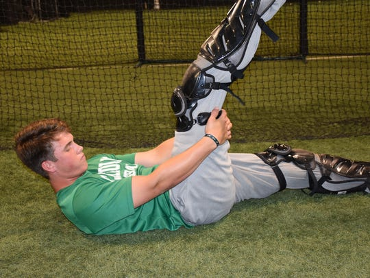Catholic High senior Sam Carpenter, shown during workout at Unlimited Training Academy, overcame a potential paralyzing ailment two years ago to return to school, finish his prep career with the Crusaders team and earn an academic scholarship at Flagler University in Saint Augustine where he has opportunity to join baseball team as walkon player.