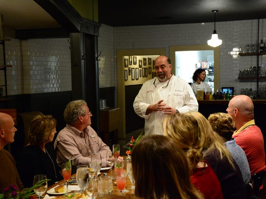 Vito Palmietto talks to customers during a multi-course chef dinner. The theme of the dinner changes every month and space is limited to 20 people.