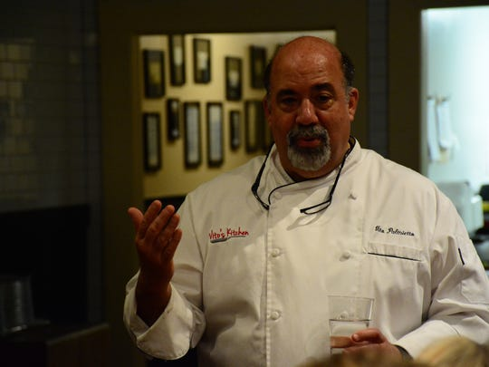 Vito Palmietto talks to a group during one of his chef dinners.