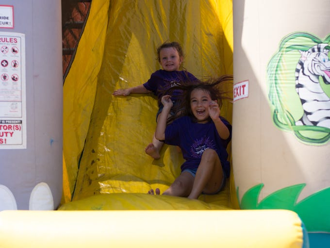 Kids enjoying the bouncehouse/slide in the play area