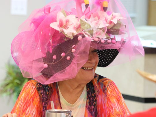 Linda Carter fashioned a pink flamingo hat at the Kentucky Derby party at the Senior Center in Morganfield.