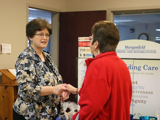 Morganfield Nursing and Rehab's LaDonna Tapp speaks with UC resident Darline Taylor about the facility.