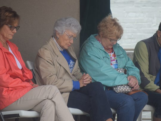 ??, Pearline Mason, Janice Hagan and ??? pray along with the pastors during the National Day of Prayer observance service.