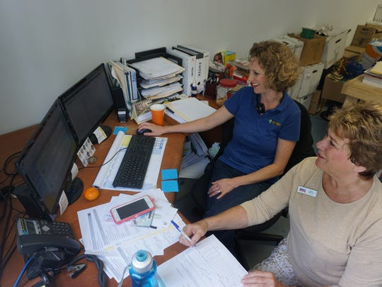 Cathy Haworth, a counselor with the Florida Small Business Development Center at Florida Gulf Coast University, works with Ruth Ann Powell, with Key Securities Services in Naples.