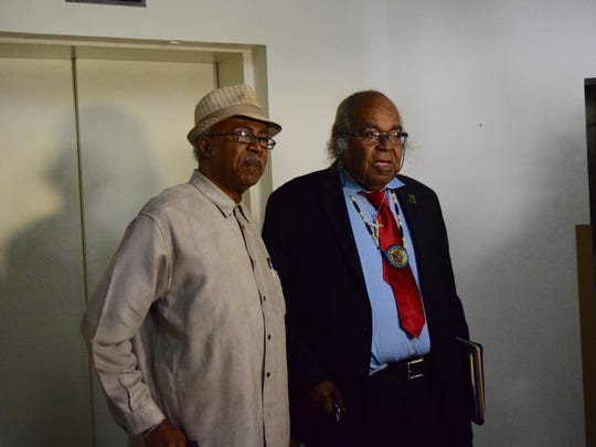 Civil Rights leaders Rev. Henry Steele, left, and John Due stand in the foyer of the Firestone Building, which used to be the Leon County Jail.