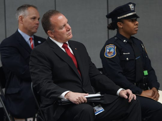 Wilmington Police Chief Bob Tracy sits next to Cpl. Monet Cummings Cintron during a press conference at the Boys & Girls Clubs of Delaware announcing Snell & Associates Consultants' national violence prevention training, Just(ice) In Time© Training Seminar for Teenagers and Young Adult Males of Color..