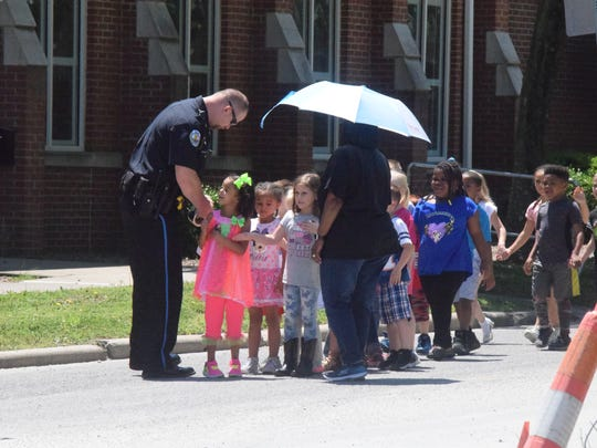 Police chief Geoffrey Deibler hands out stickers as