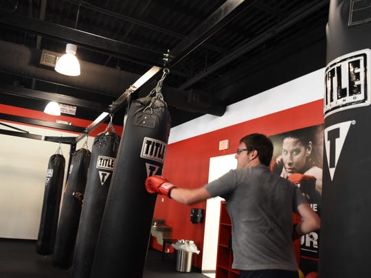Reporter Tad Mast practices his boxing moves at Title Boxing Club in Naples during a 60 minute class on May 9, 2017.