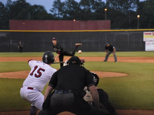 Tate's Logan McGuffey prepares to bunt in Tuesday's Region 1-7A quarterfinal game against Niceville.