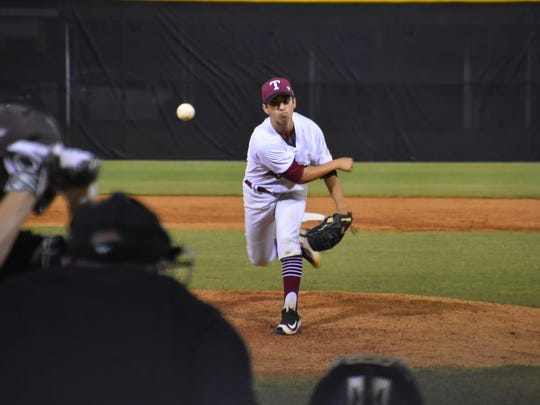 Tate High pitcher Gabe Castro delivers a pitch in the seventh inning of Wednesday's night's Region 1-7A quarterfinal. The Aggies won 5-3 to advance to face Milton next Tuesday.