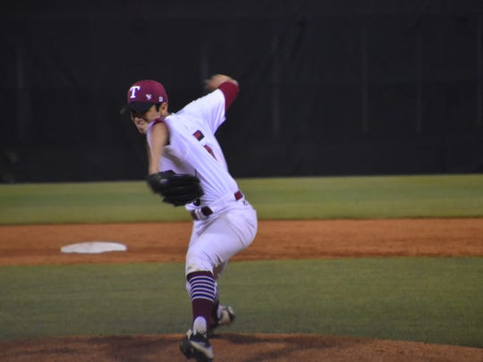 Tate High pitcher Gabe Castro prepares to deliver a pitch in Tuesday night's Region 1-7A quarterfinal game against Niceville.