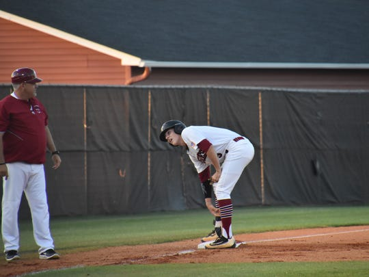 Tate High coach Greg Blackmon checks with Mason Land after he successfully slid into third on his first-inning triple in Tuesday's Region 1-7A quarterfinal.