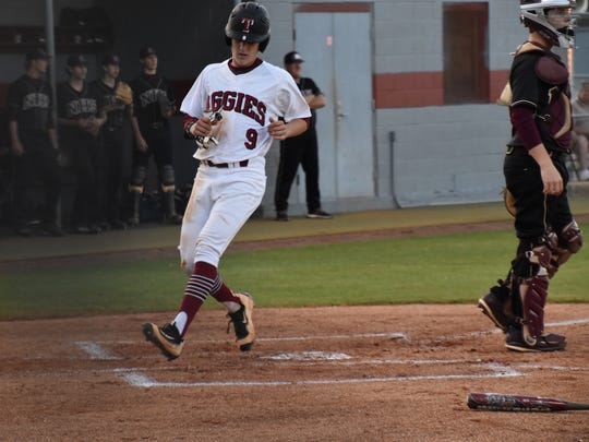Tate's Mason Land crosses the plate with Tate's first run in Tuesday's Region 1-7A quarterfinal game.  He tripled in the first inning and scored on a ground out that trimmed the Aggies deficit to 2-1 at the time.