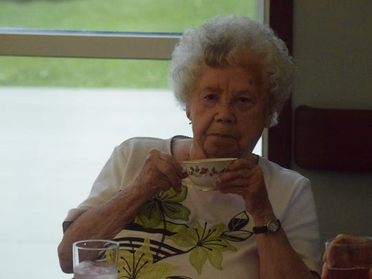 Betty Henry sips her tea during the Mother and Daughter