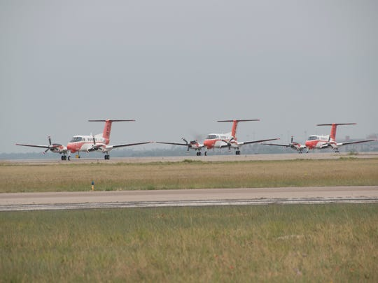 """The training squadron THREE FIVE or VT-35 conducted one last flyover May 12, 2017 in the TC-12B """"Huron"""" aircraft"""