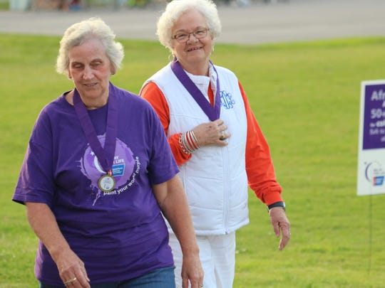 Paulette Wolfe and Mary Lou Loxley complete the survivors lap.