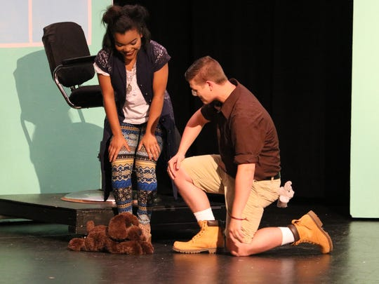 JaQuazia Fletcher and Cameron Quinn smile adoringly at a puppy in one of the scenes.